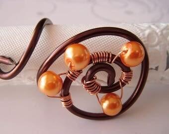 This unique ring, spiral Brown wire, beads orange pastel