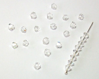 25 bicones 4 mm SWAROVKI Crystal authentic crytal tranparent 001