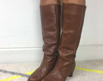 Brown leather riding boots with wooden stacked heel.