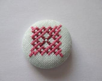 Pink embroidered button