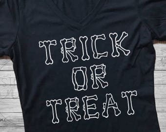 Trick Or Treat Halloween Shirt. Women's Trick or Treat Shirt. Halloween Shirt. Trick or Treat. Black Halloween Shirt. Women's V Neck Shirt.