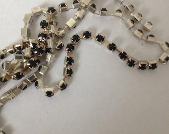 Mini black rhinestone mounted in silver plated chain
