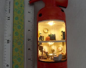 Cigarette lighter as a doll house