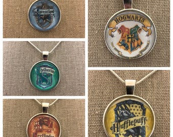 Harry potter jewelry.Hogwarts houses.Ravenclaw necklace.Hufflepuff necklace.Gryffindor necklace.Slytherin necklace.Hogwarts necklace