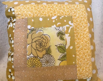 Throw pillow in yellows and gold with vintage fabric