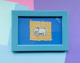 Elephant in blue frame