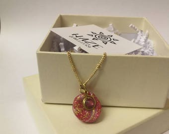 Pink and gold charm necklace