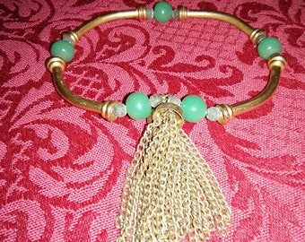Vintage gold tone and turquoise bangle bracelet with fringe