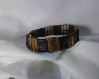 Leather cuff with brass accents