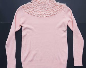 Pretty and pink ruffle turtle neck