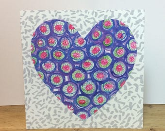 Colourful Flowery Heart on a Speckled Grey Background