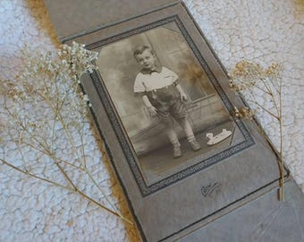 Vintage Photo in folder. Young Boy with Toy. From about 1920s