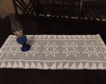 Handmade crocheted table runner with sawtooth stars