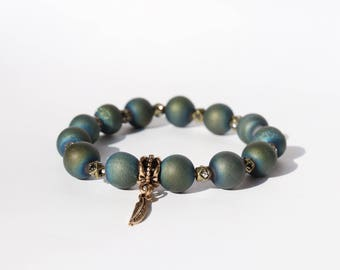 Blue/green beaded bracelet with gold accents