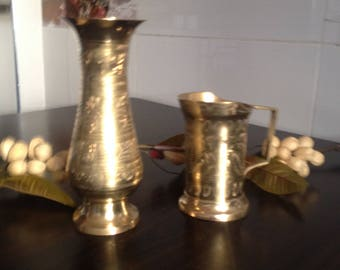 A decorated antique brass vase and a large brass cup decorated with an Indian style