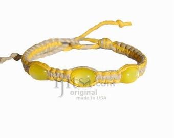 Yellow and natural flat hemp bracelet or anklet with three yellow resin beads