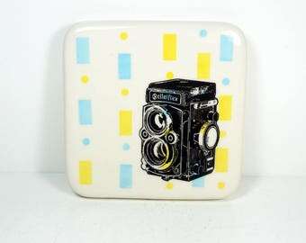 tile with blue and yellow background and a Rolleiflex camera print, ready to ship