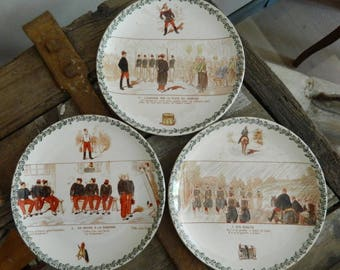 3 French Antique Choisy Le Roi Wall Plates with Humorous military scenes. Set of 3  Plates Stamped Choisy le Roi.