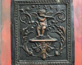 Ornate Copper Panel with Flute-Playing Cherub
