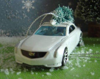 Cadillac Elmiraj car with Christmas tree ornament