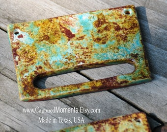 The LaDonna, a pottery pendant bead with a industrial look in worldly mix