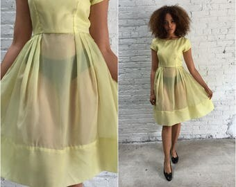 50s dress / vintage 50s pastel yellow taffeta party dress / 1950s pale yellow cupcake prom dress