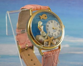 Mermaid Watch with sand shells starfish and a fish