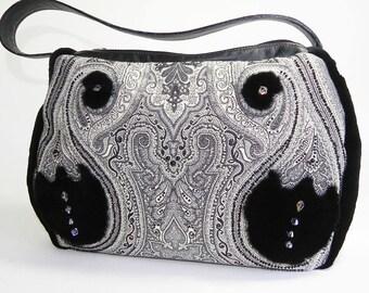 Black and white tapestry handbag