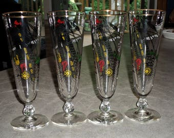 set of 4 Treasure Island Pirate Ship stemware Libbey Glass compass rose beer water pilsner