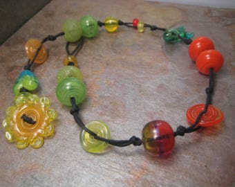 Beads on cord uno, a glass bead necklace