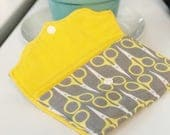 Large card wallet made in a Scissors fabric.  Holds lots of cards with a snap closure!
