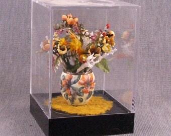 Peach tulips arrangement in an eggshell pot all inside an acrylic showcase box