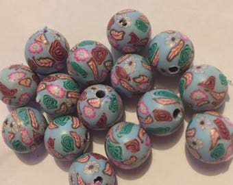 Pack of 14 x 10mm polymer clay round aqua with multi coloured flower beads.