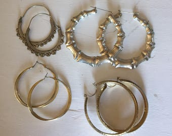 4 pairs pre owned Hoop Earrings Silver and Gold toned.