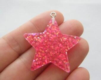 2 Star pink resin pendants S173