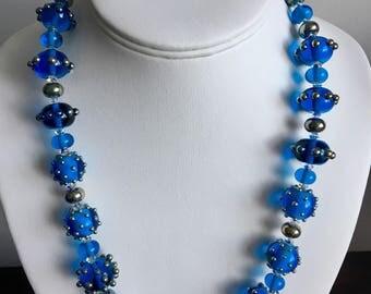 Necklace: lampwork glass beads, Swarovski crystals, sterling silver