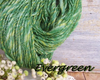 Handspun hand dyed wool bamboo blend thick and thin singles Evergreen chunky bulky yarn