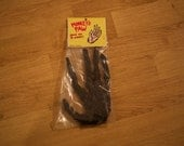 monkey's paw rubber toy horror taxidermy luck charm dime store style