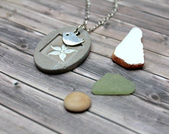Concrete necklace with flower stamp and metal bird