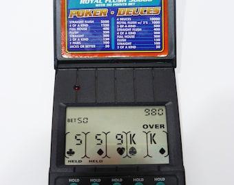 Radica Handheld WINNER POKER Royal Flush 5000 Deuces LCD Electronic Card Game Flip Top Hand Held