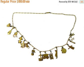 """ON SALE Antique Gold Washed Articulated Charm Necklace 25"""" Long w/ 15 Charms #2370"""
