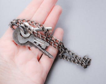 Set of 3 antique skeleton keys with key ring and chain. Dark patina
