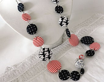 Long necklace in black, red and white fabrics, rabbits, stripes and peas, with glass beads