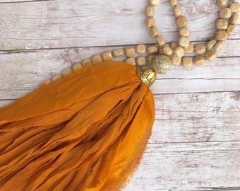 Long Sari Silk tassel necklace. Pumpkin orange. Fabric Tassel Necklace. Boho glam. Tassel necklace. Sari necklace.