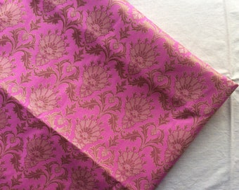 One yard of Indian brocade fabric in pink with dull gold in a regal pattern