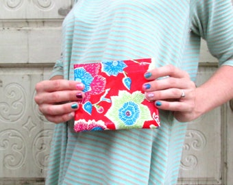 "Oilcloth coinpurse, red, blue, and green mod floral print, 5"" by 5.5"""