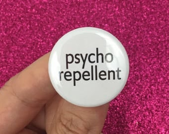 psycho repellent. 1.25 inch button. this is your shield for crazy
