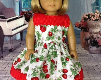 18 inch doll dress and hair clip.. Fits American Girl Dolls.  Strawberry print with red dot contrast
