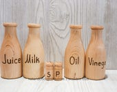 Milk, juice, Oil and Vinegar, salt and pepper.   You choose some or all!  Wooden bottles for play kitchen.