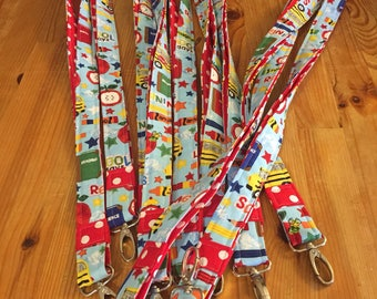 Teacher lanyard, school lanyard, blue lanyard, red lanyard, apples, school bus, crayons, polka dots